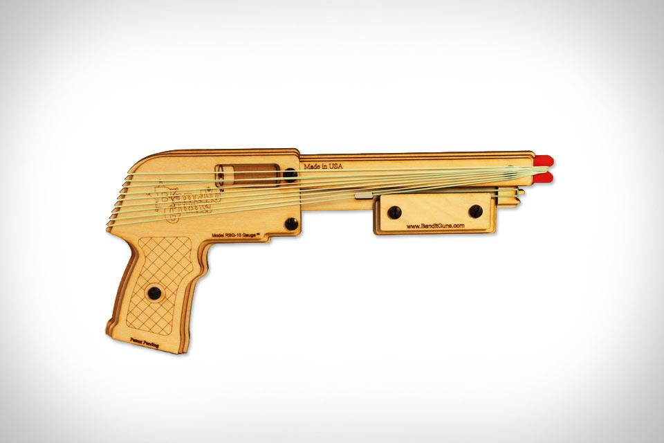 Стреляющее денежными резинками оружие Bandit Gun